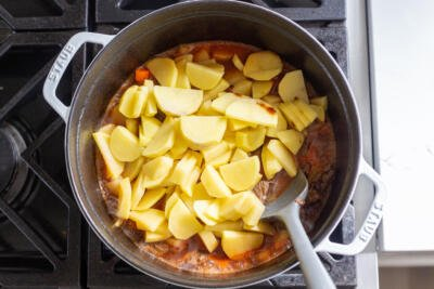 Pot with potatoes and the sauce