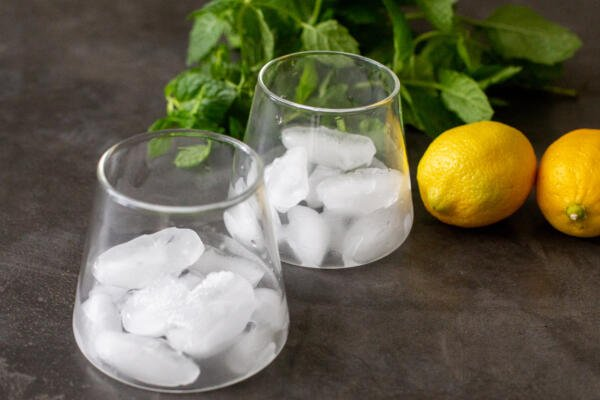 Cups with ice and lemon and mint