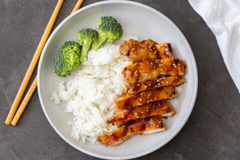 chicken with rice and broccoli on a plate