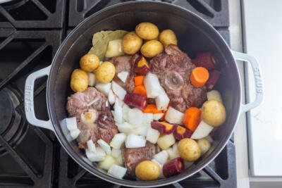 Oxtail and vegetables in a pot