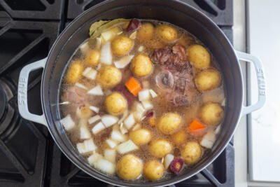 Oxtail with veggies in a pot with liquid