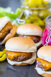 A pile of sliders with pickled veggies