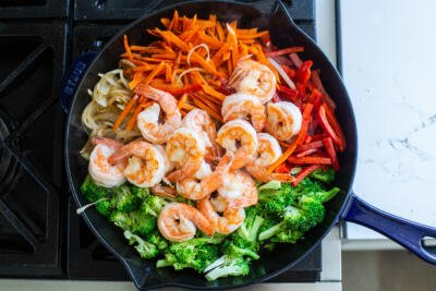 Shrimp with veggies in a pan