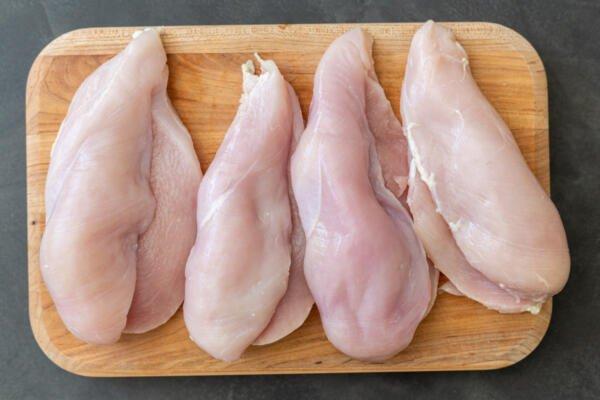 Butterflied chicken on a cutting board