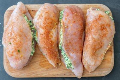 Stuffed chicken breast in a cutting board
