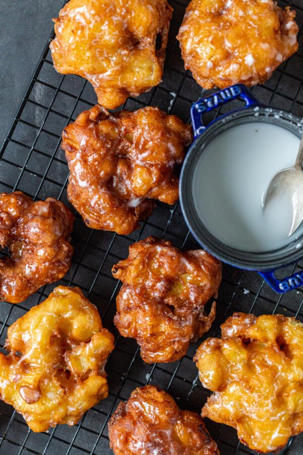 Apple Fritters on a cooling rack with glaze