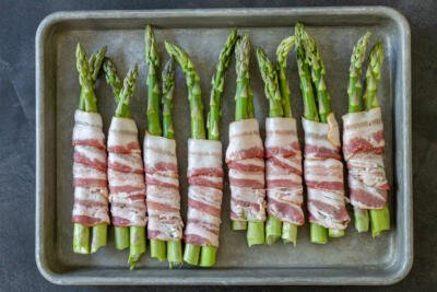 raw asparagus wrapped with bacon