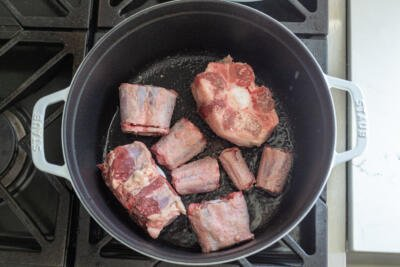 Oxtail browning in a pot