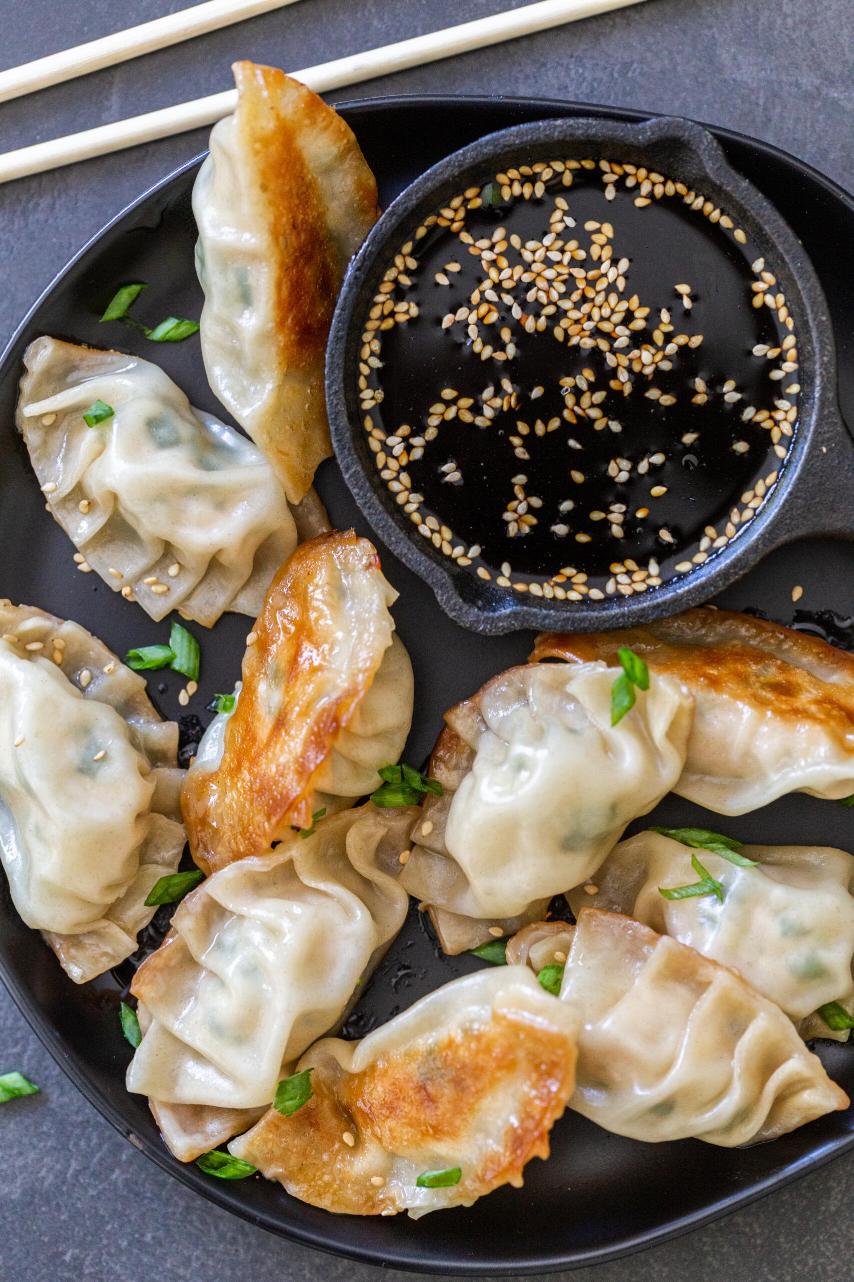Gyoza on a plate with soy sauce
