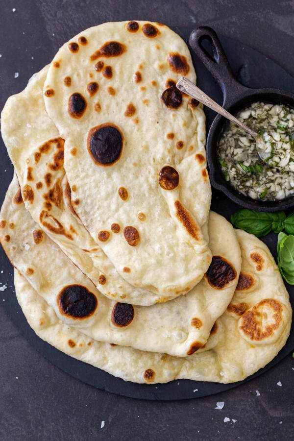 Naan Bread with garlic and herbs on a plate