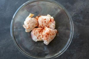 seasoned chicken thighs in a bowl
