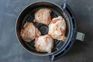 Chicken Thighs in an air fryer basket