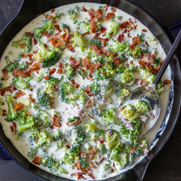 broccoli with bacon in alfredo in a pan