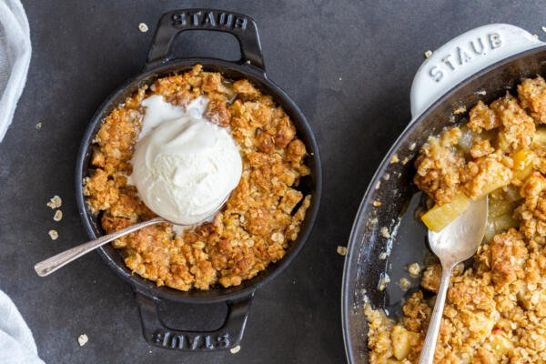 Apple crisp in a pan with ice cream