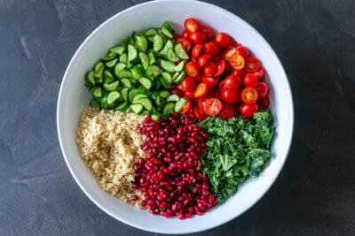 All the ingredients for Quinoa Salad in a bowl