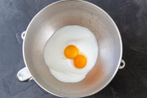 sugar and egg yolks in a mixing bowl