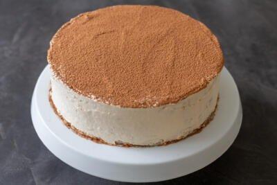 Tiramisu crepe cake on a cake stand