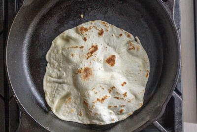 tortilla cooking in a pan