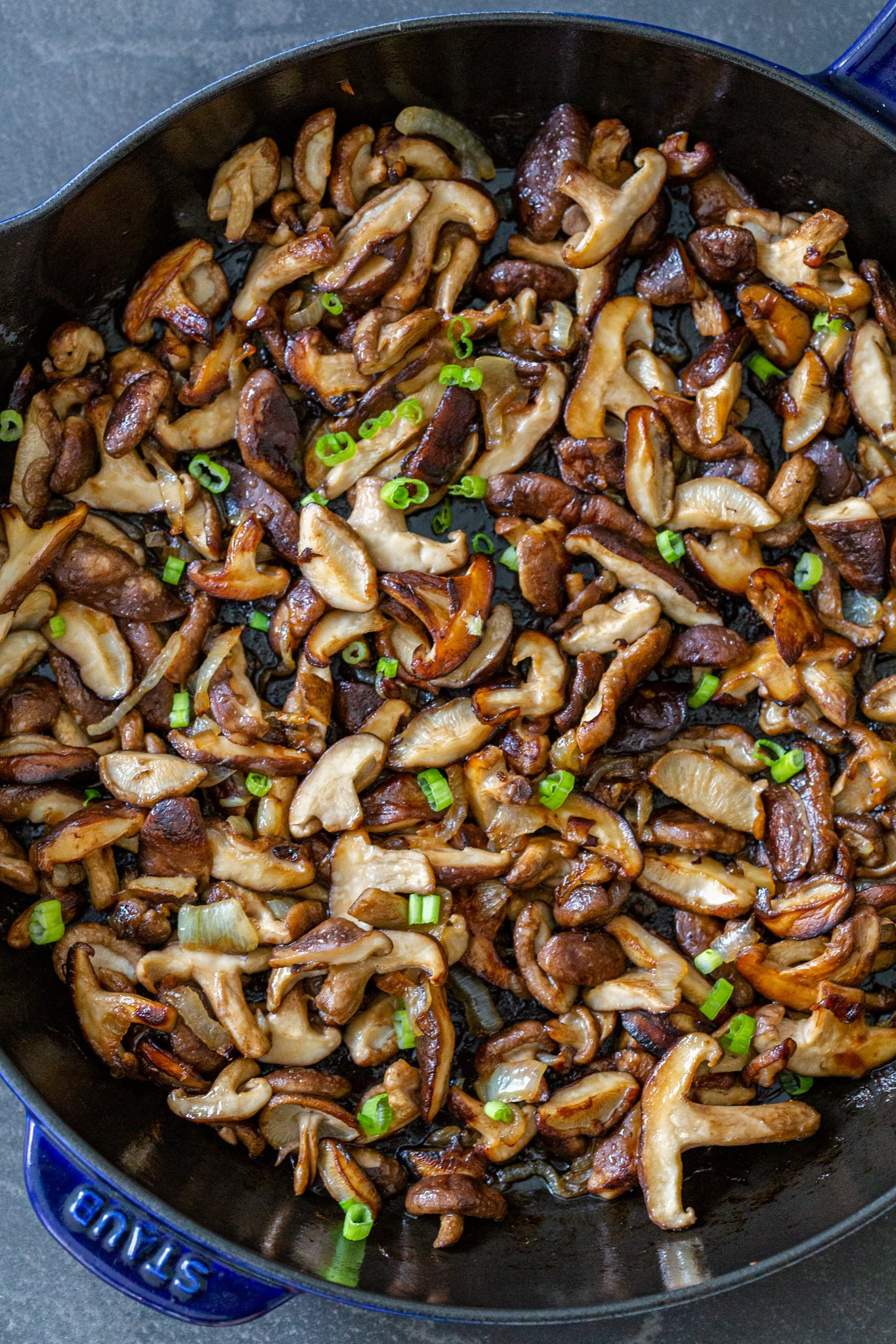 fried shitake mushrooms in a pan