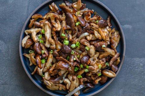 fried shitake mushrooms in a pan