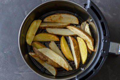 Air fryer potato wedges in a basket