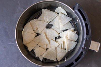 Air fryer basket with tortilla chips