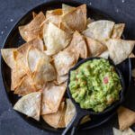 Air fryer tortilla chips and guac on the side