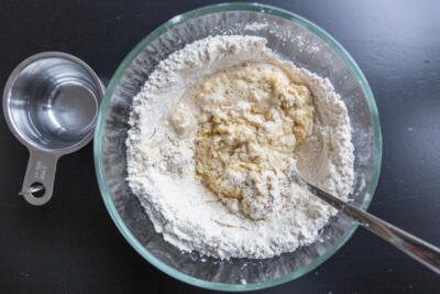 flour with wet ingredients in a bowl