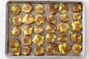 smashed potatoes on a baking sheet