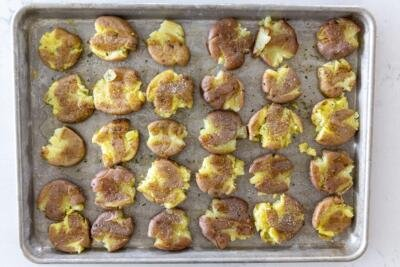 smashed potatoes on a baking sheet