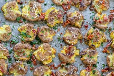 Smashed potatoes with herbs and bacon