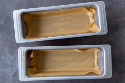 two bread pans lined with parchment paper