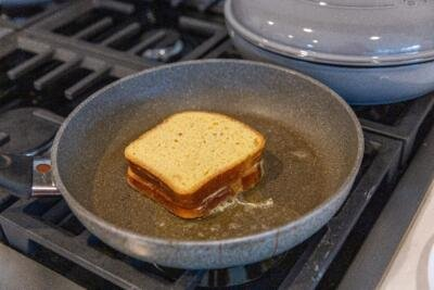stuffed french toast cooking on a pan