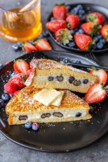 Stuffed French toast on a plate with berries