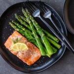 Baked salmon on a plate with asparagus