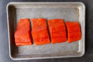 baking sheet with pieces of salmon