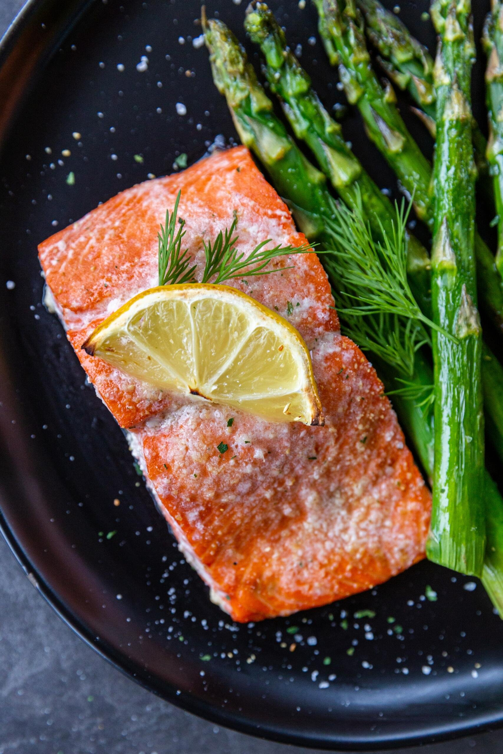 Baked salmon on a plate with asparagus