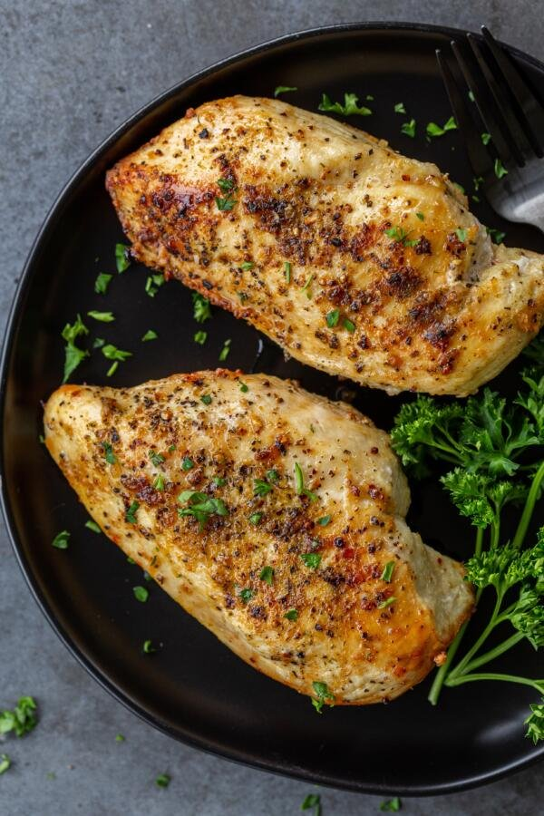 Chicken breast on a plate with herbs