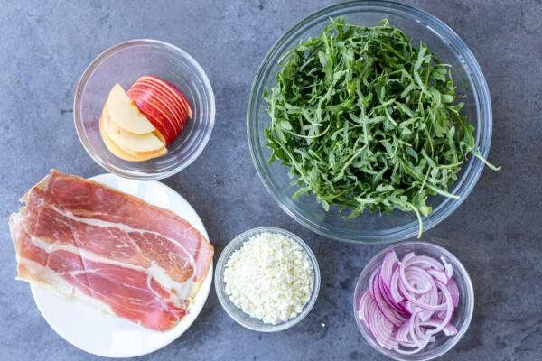 Ingredients for arugula salad on a counter