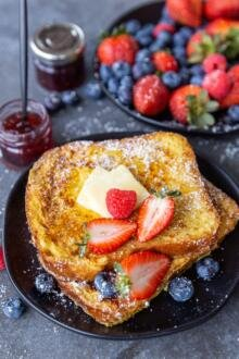 French toast on a plate with fruits