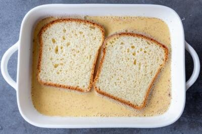french toast soaking in a dish