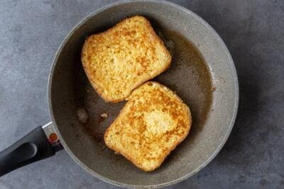 French toast cooking on a frying pan