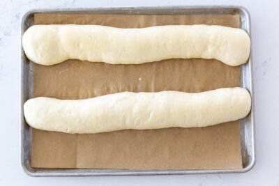 French bread on a baking sheet