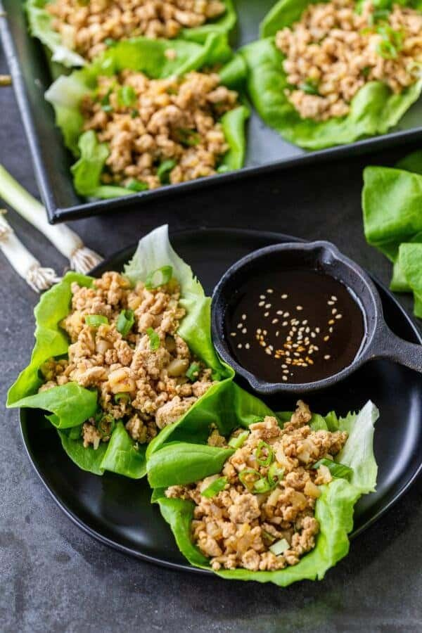 Chicken Lettuce wraps on a plate with sauce