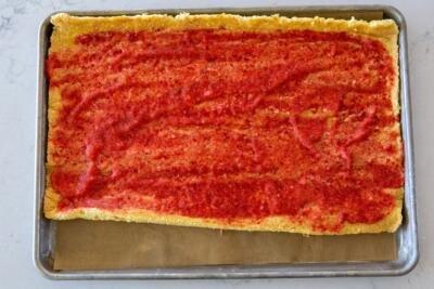 strawberry jam over a sponge cake