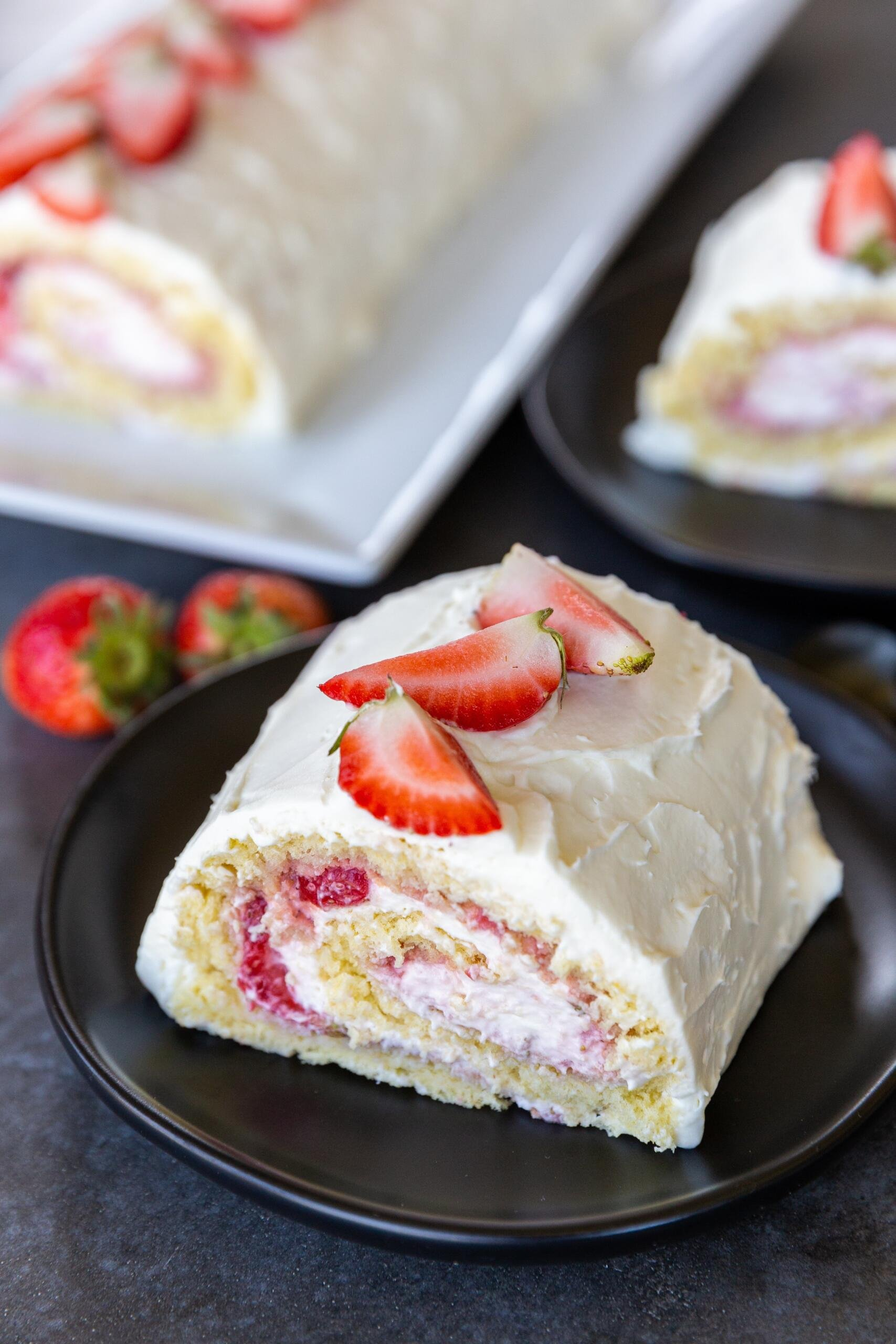 strawberry cake roll on a plate