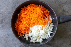 Carrots and onions in a frying pan