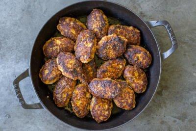browned buckwheat patties in a pan