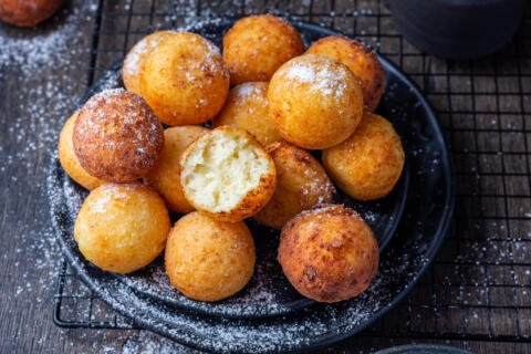 cooked donut holes on a plate