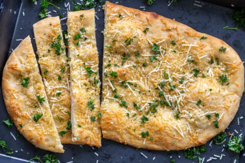Baked flatbread cut into slices